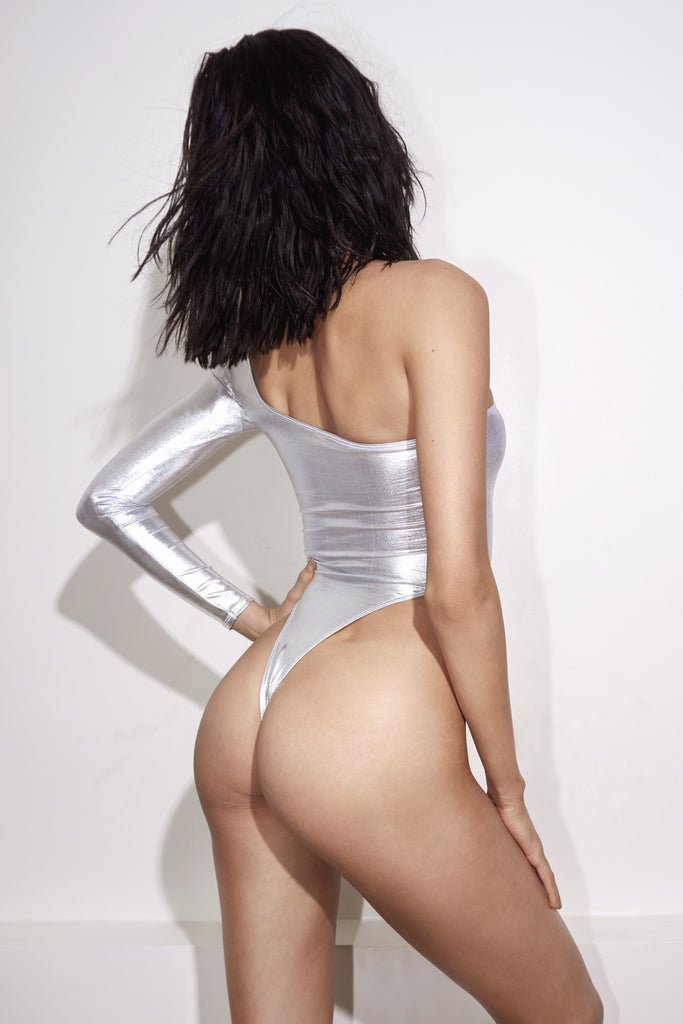 Back View Silver one shoulder one piece swimsuit, low-back and high-cut sides.