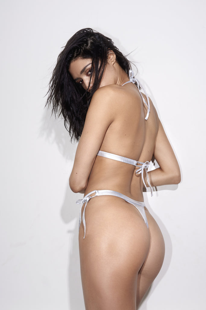 Back View - The Jax is a metallic silver tie string bikini with thong back