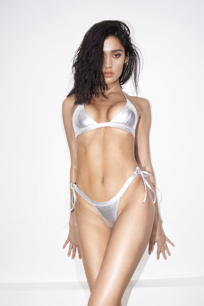 Front View - The Jax is a metallic silver tie string bikini with thong back