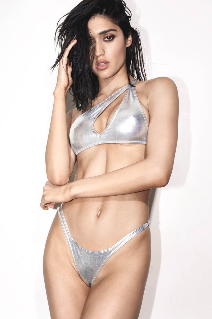 Metallic silver one shoulder asymmetric two piece with a thong strap and adjustable waist straps