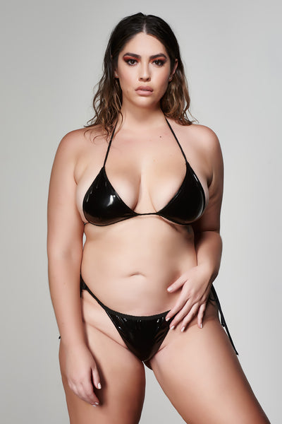 Plus size model wearing black latex two-piece bikini.