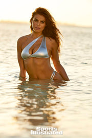 As Seen on Brooks Nader in SI swimsuit. The Celine is an one should asymmetric metallic silver two piece with a thong strap and adjustable waist straps