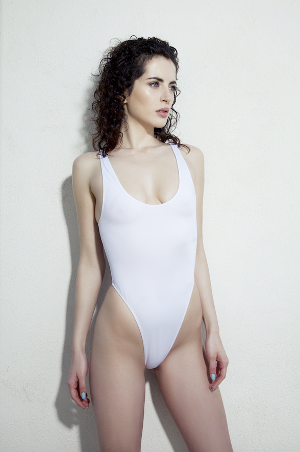 White One-Piece Swimsuit scoop neckline, low, back, and high-cut sides As seen in Sports Illustrated Swimsuit Edition