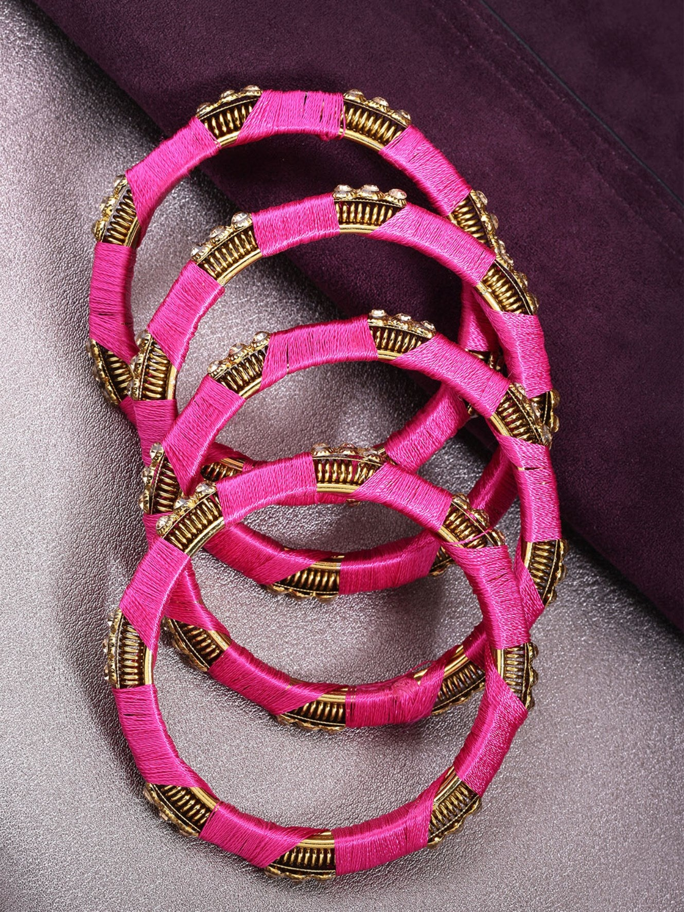 Set Of 4 Stones Studded Silk Threaded Bangles in Pink Color