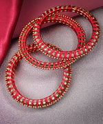 Priyaasi Set Of 4 Stones Studded Silk Threaded Bangles in Maroon Color