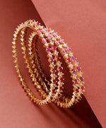 Priyaasi Set Of 4 Gold-Plated Ruby And American Diamond Studded Bangles in Magenta and White Color