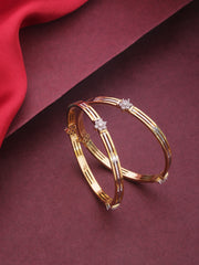 Set Of 2 Dual Toned American Diamond Studded Bangles in Floral Pattern
