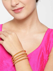 Set Of 4 Gold-Plated Red Stones Studded Textured Bangles