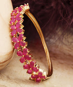 Priyaasi Ruby Stones Studded Gold-Plated Bracelet in Floral Pattern