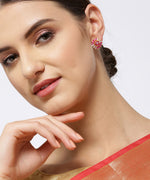 Priyaasi Gold-Plated American Diamond and Ruby Studded Floral Stud Earrings