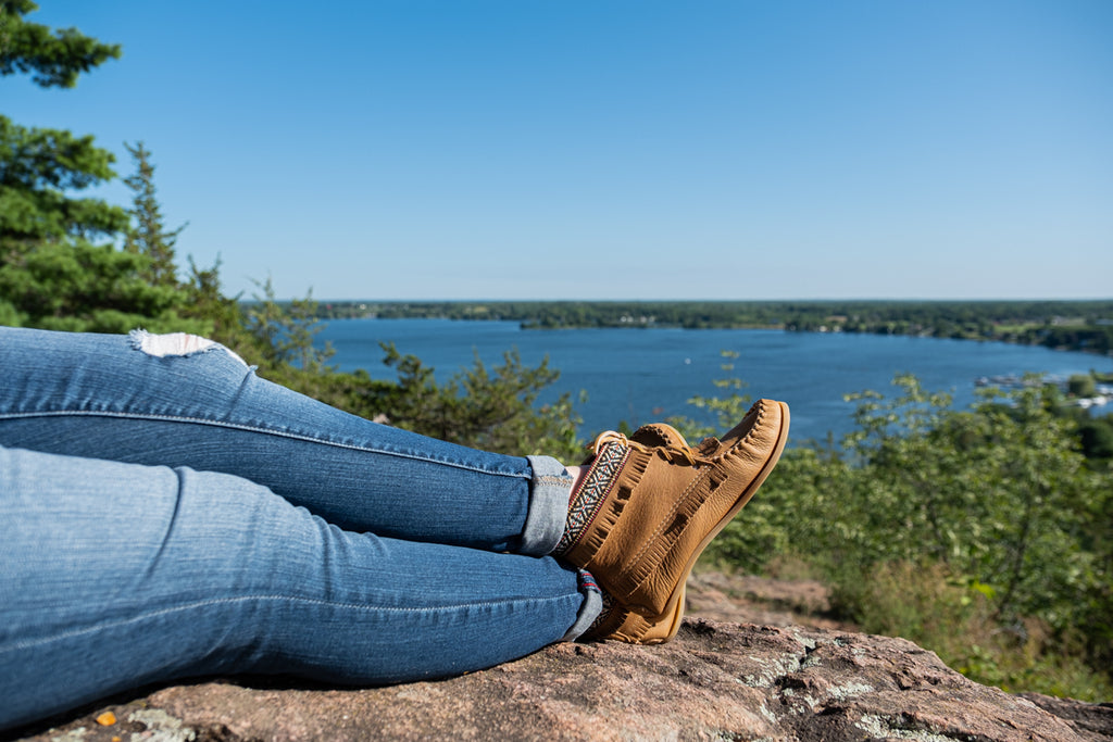moccasin boots scenic background