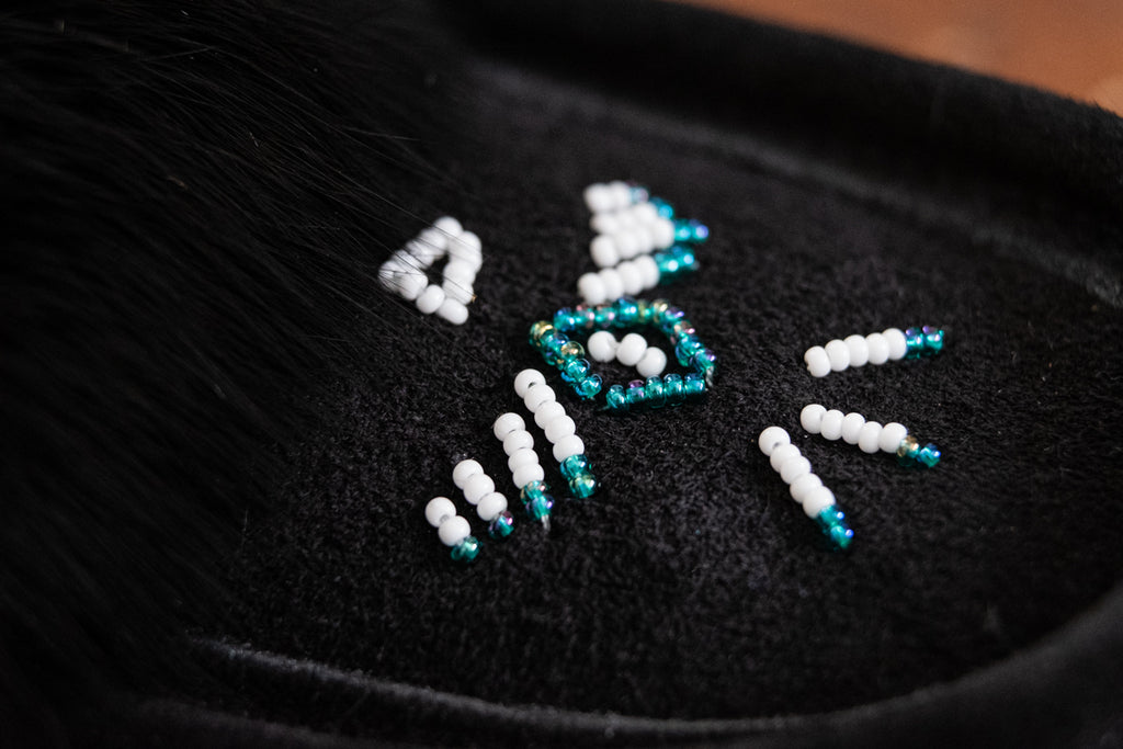 close-up of hand-beading on authentic moccasins