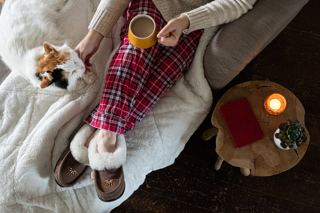cozy winter hot cocoa and fuzzy cat and cover moccasins