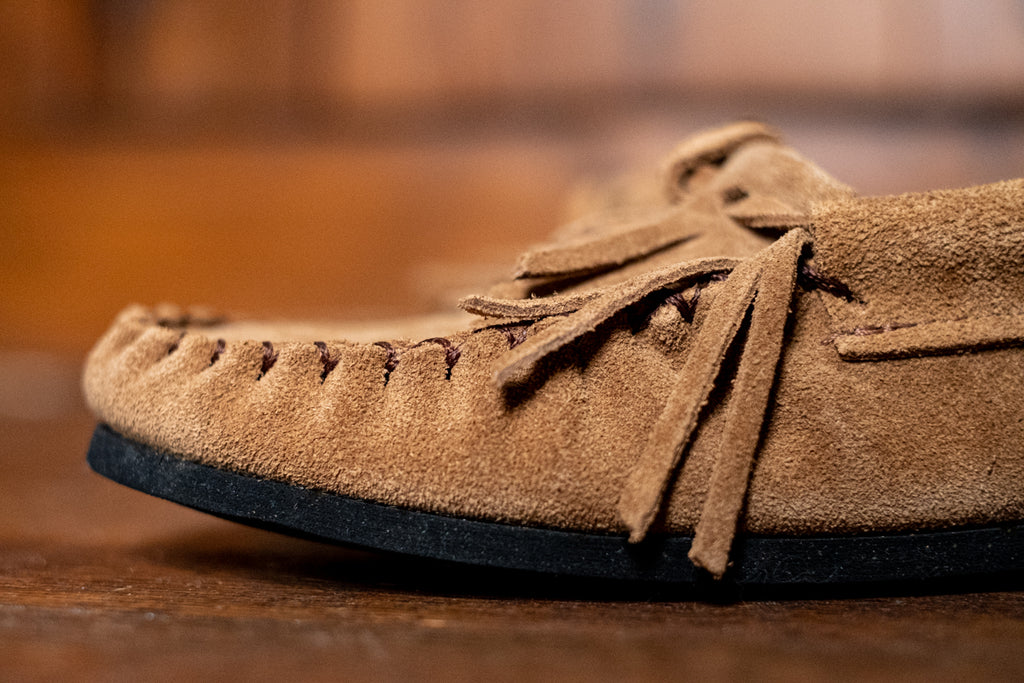 close-up of genuine suede leather moccasins with fringe