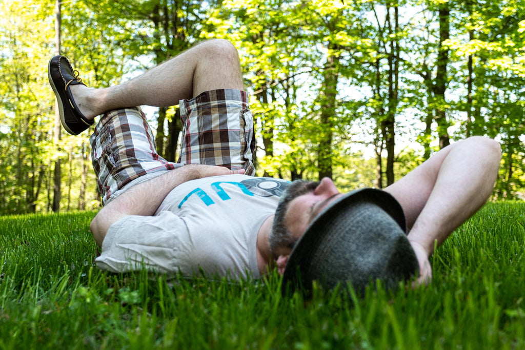 relaxing in the grass with a pair of moccasins