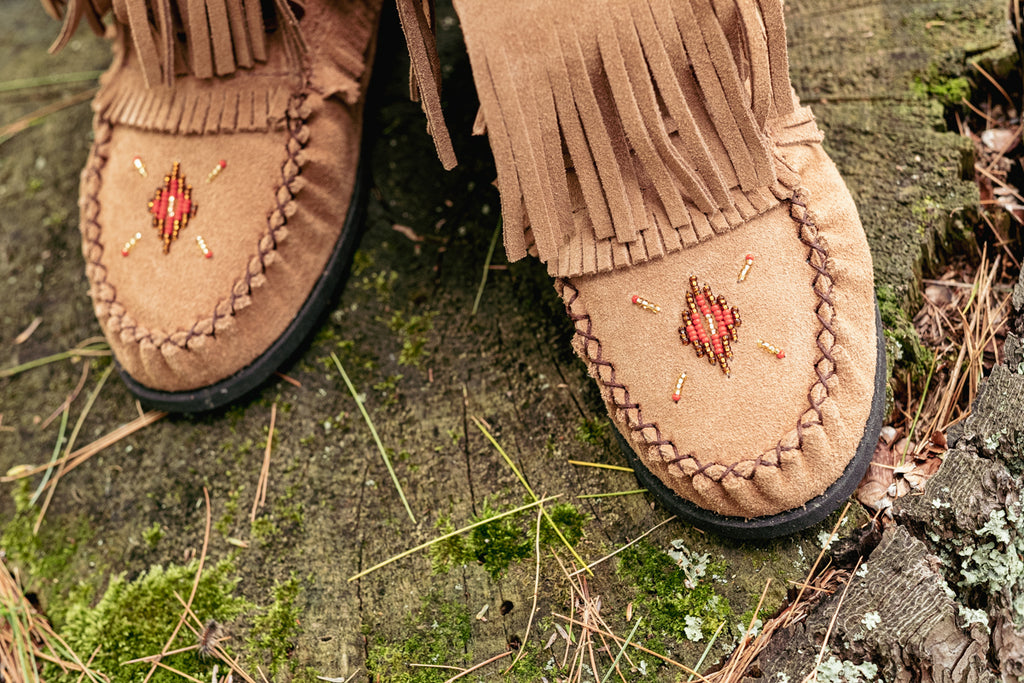 hand-beading on moccasins laurentian chief canada
