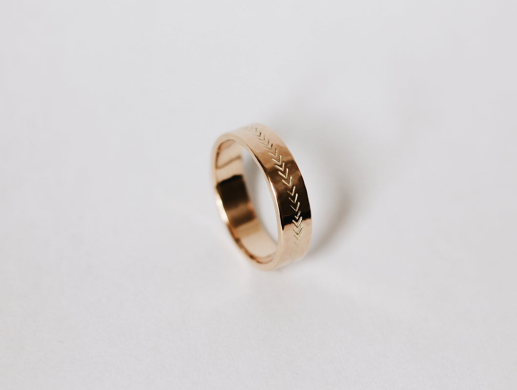 Arrow Stamped Yellow Gold Wedding Band