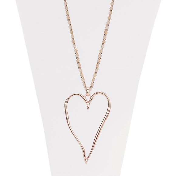 Nude and rose gold necklace with faceted beads and large wavy heart pendant