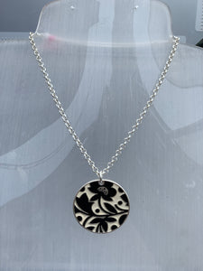 Cicular reversible pendant on a chain