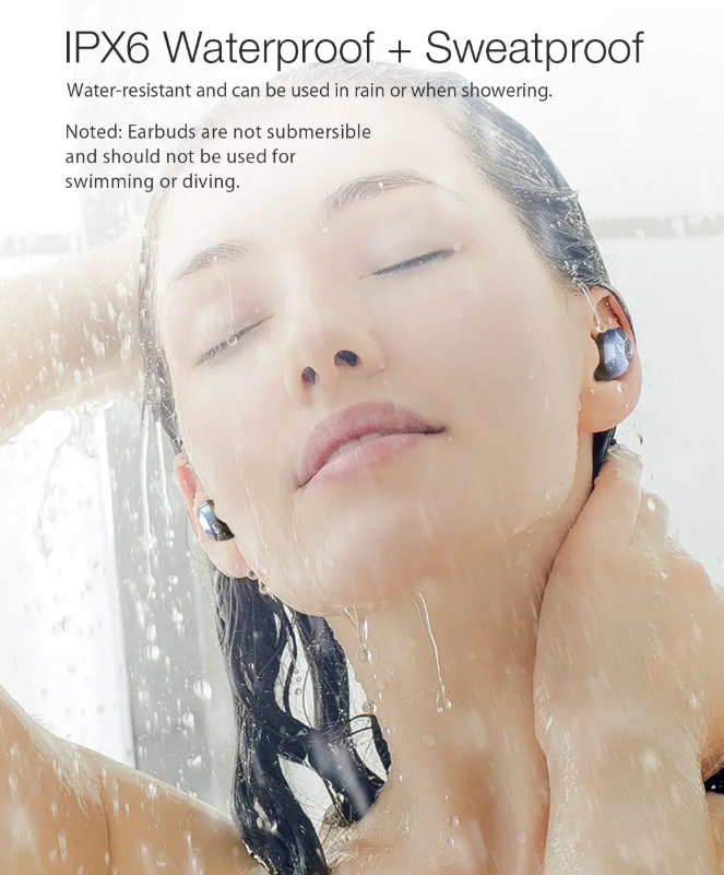 shoulders and head of woman in shower wearing earbuds