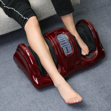 red foot and leg massager showing woman's leg in right side and left foot in other groove.