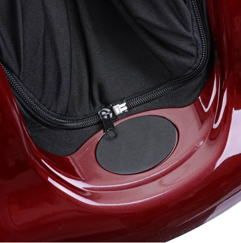 view of black zip out fabric in leg or foot groove of red leg and foot massager