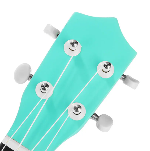top of spearmint color ukulele with four white tuning pegs