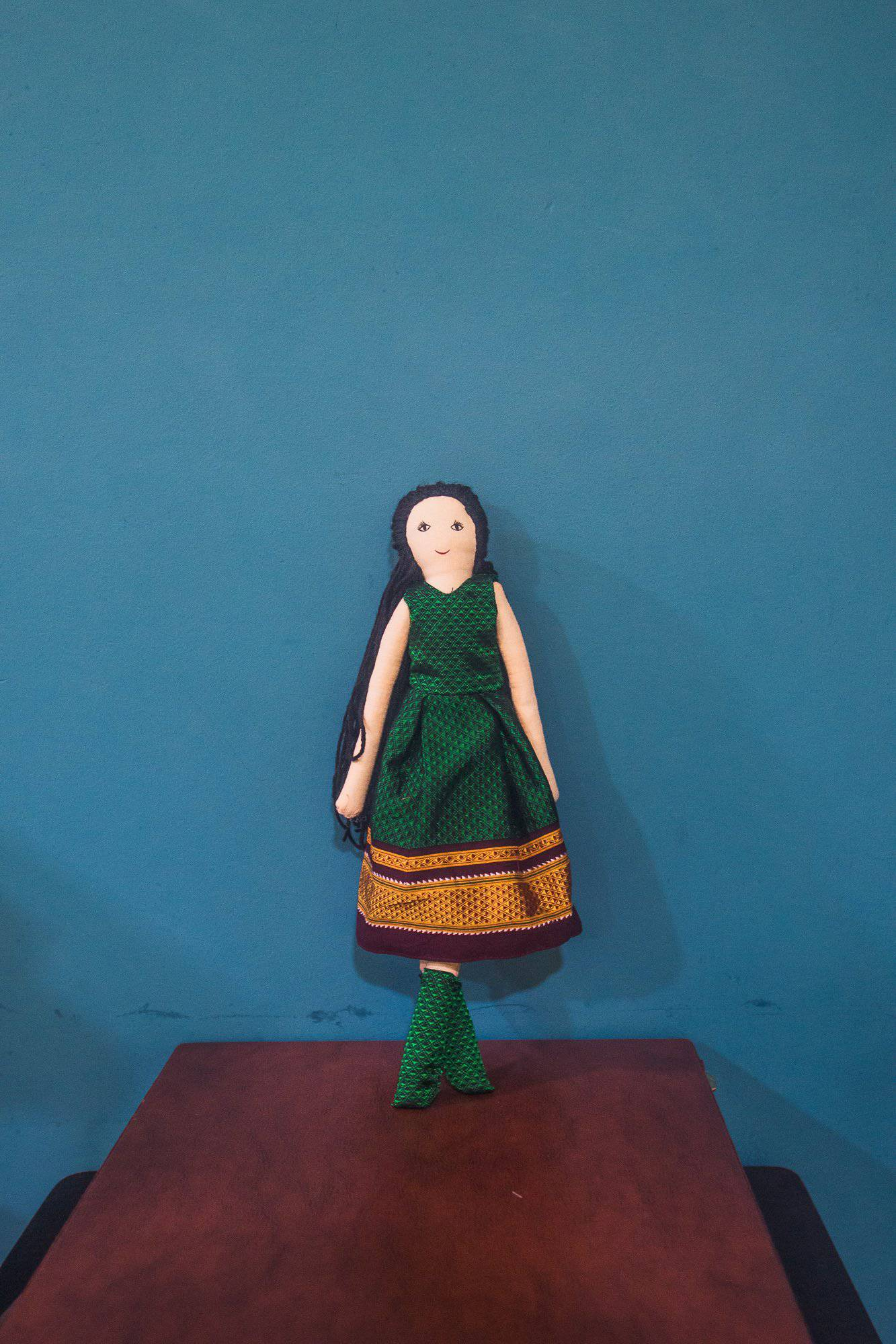Kids fabric doll with rich green khunn frock