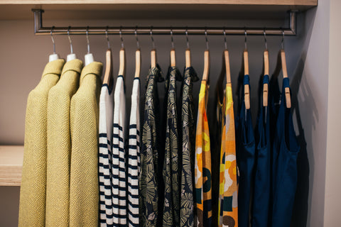 clothes rack with colourful happy tops