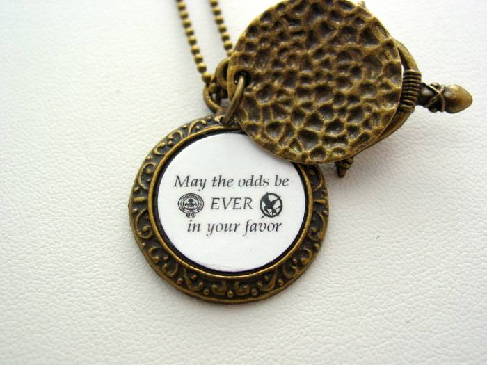 Hunger Games May The Odds Be Ever In Your Favor Mockingjay Hidden Necklace