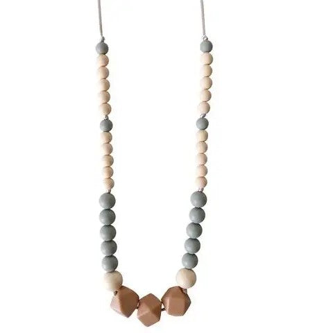 Silicone teething necklace made of grey, beige, and clay colored silicone beads on a white satin cord