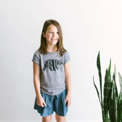 Girl wearing gray Sister Bear t-shirt by Gladfolk