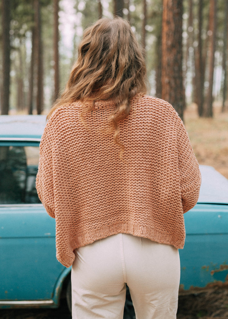 lavender sweater in peach