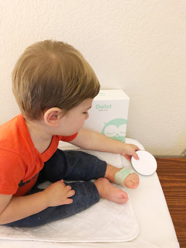Baby wearing The Owlet Smart Sock Monitor