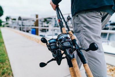 Angler carrying multiple reels