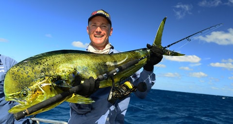 Angler holds up large green fish