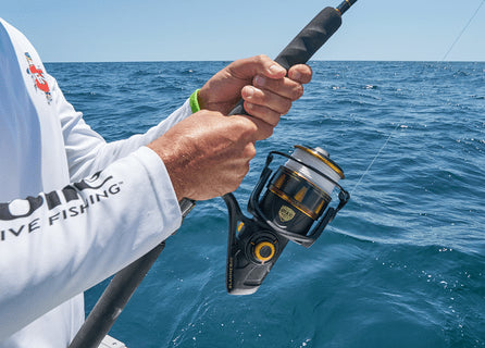 Close-up of hands on fishing reel