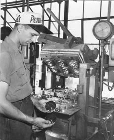 Factory worker with Penn hat
