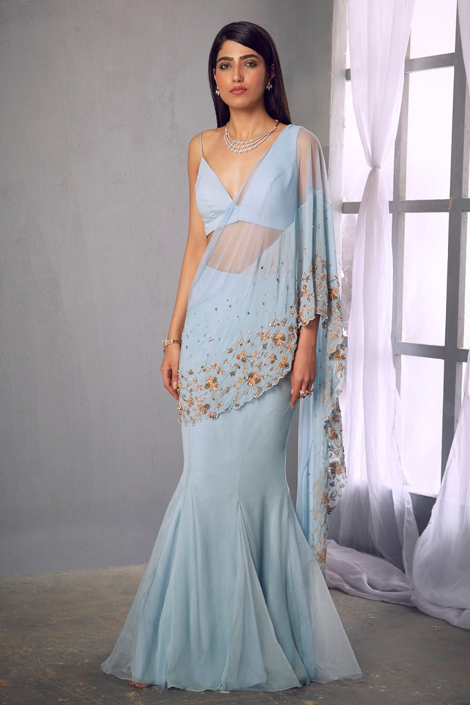 Powder blue fish tail skirt and asymmetric blouse
