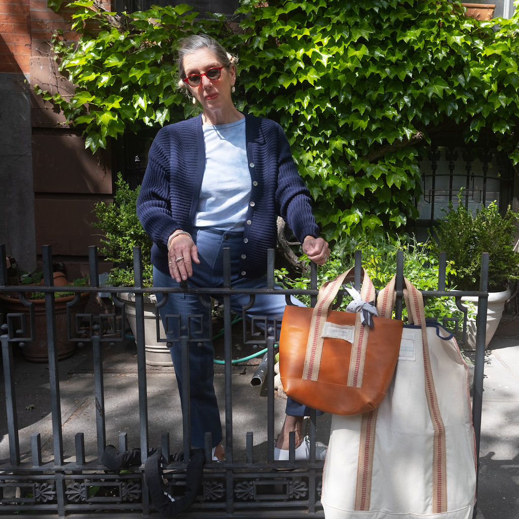 Susannah Thompson with her market bag and laundry bag wearing M.PATMOS Amelia Bomber