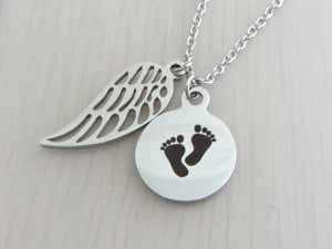 single angel wing charm and a laser engraved baby footprints charm on a stainless steel chain