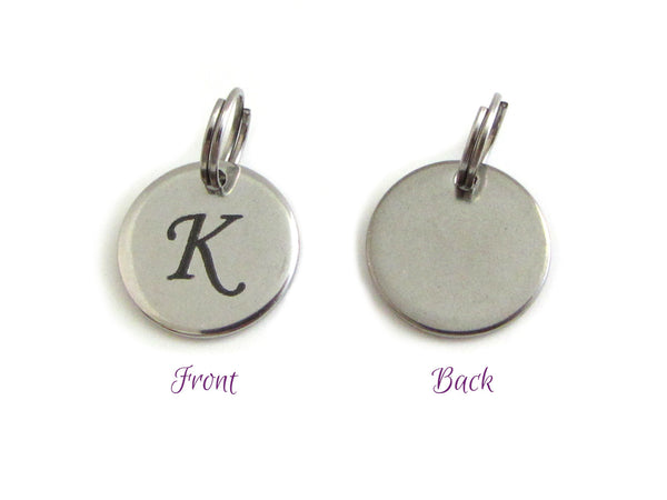 stainless steel disc charm front has letter, back is plain