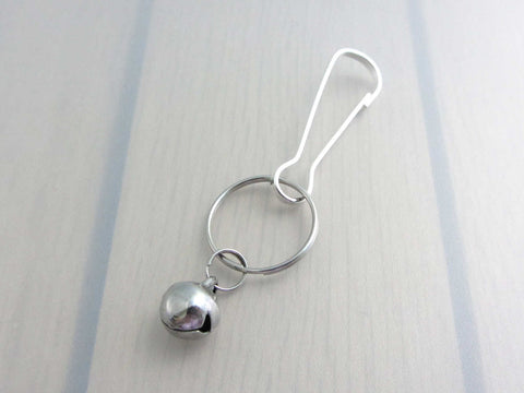 stainless steel bell charm on a bag charm with snap clip hook