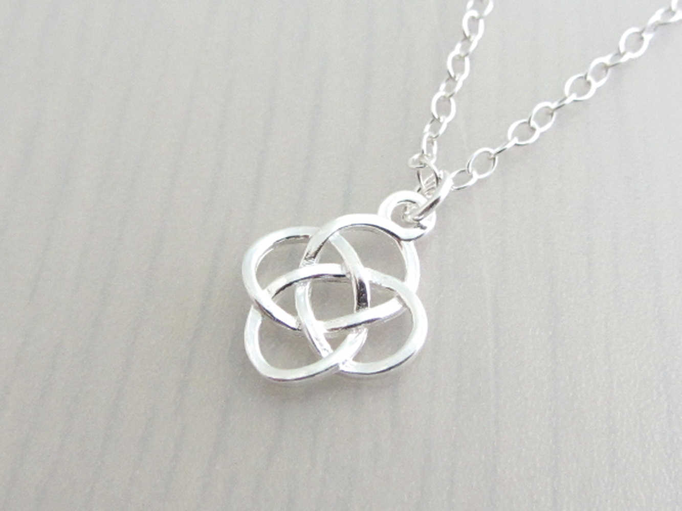 silver celtic knot charm on a silver chain