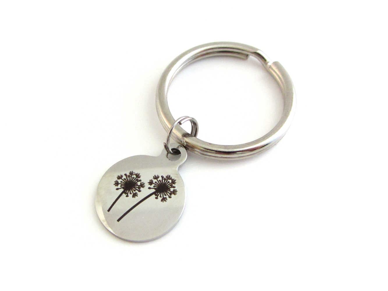 laser engraved dandelion flowers charm on a keyring
