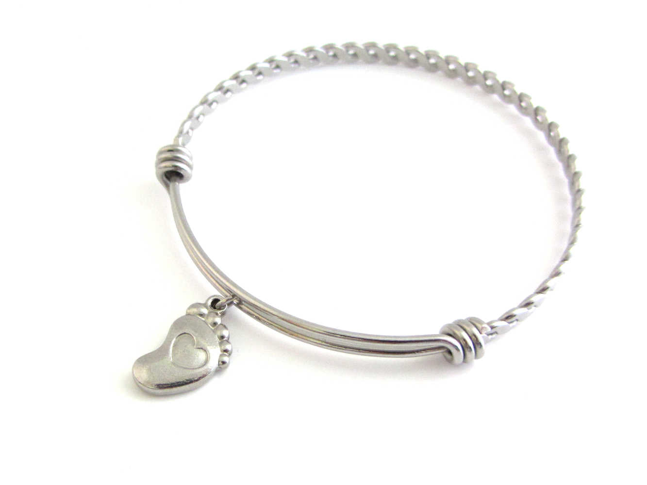 stainless steel single foot charm with indented heart on a bangle with braided twist pattern