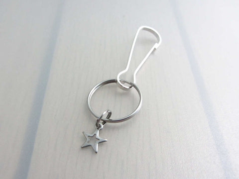 stainless steel hollow star charm on a bag charm with snap clip hook