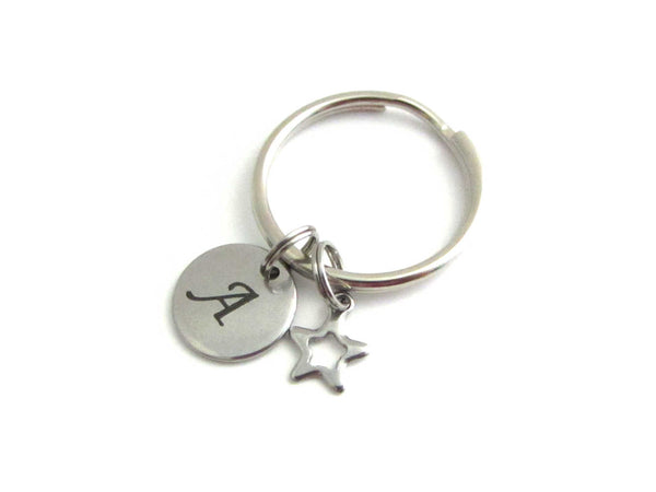 stainless steel laser engraved capital initial letter disc charm and hollow star charm on a keyring