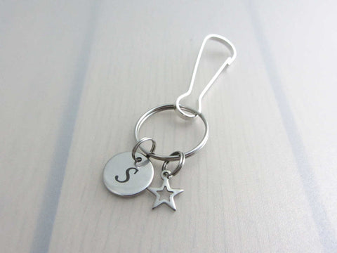 stainless steel laser engraved capital initial letter disc charm and hollow star charm on a bag charm with snap clip hook