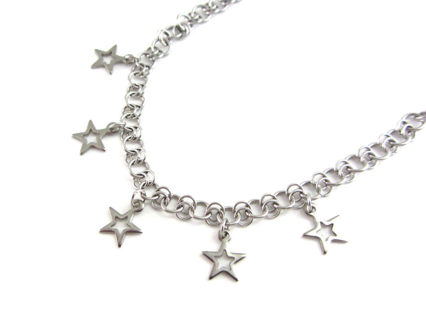 five small hollow star charms on a handmade chainmaille stainless steel chain necklace